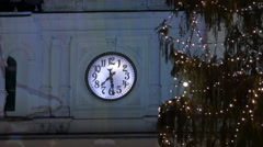A Christmas tree next to the Rathaus' clock, in Hauptplatz, Graz Stock Footage
