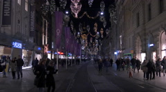 Passing by Humanic store on Herrengasse on Christmas in Graz Stock Footage