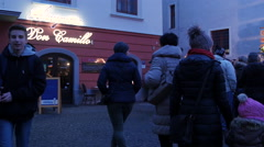 People walking by Don Camillo Restaurant on Christmas in Graz Stock Footage