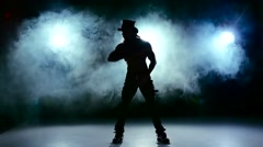Erotic show of man, go on dance and spin in smoke, on black, slow motion Stock Footage