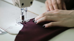 Stitching On A Sewing Machine. Piece of clothing Stock Footage