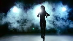Go on dancing of beautiful sexy girl in erotic black suit clothes, smoke, slow - stock footage