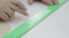 drawing with a pencil and ruler. mark on paper. - stock footage