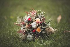 Wonderful luxury wedding bouquet of different flowers - stock photo