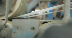 CU and Shallow Focus Shot of a Lead Sheet Passing Through a Roller (4K) - stock footage