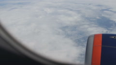 Wing of passenger airplane. the view through the window. above the clouds - stock footage