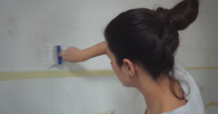 Young woman decorating new appartment Stock Footage