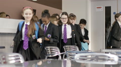 4K Happy group of school children entering school cafeteria at lunch time Stock Footage