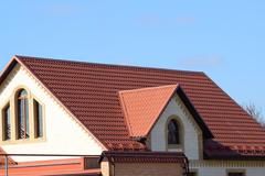 House with a roof made of metal sheets Stock Photos