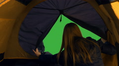 Young blonde female hiker opening the tent and enjoying the view Stock Footage