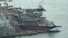 Industrial shipyard, maintenance of cargo vessels in Busan port, South Korea Stock Footage