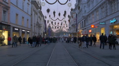 Walking by Douglas and Mango stores on Herrengasse on Christmas in Graz Stock Footage