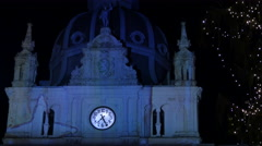 Clock and statue on the facade of the Rathaus, in Hauptplatz square, Graz Stock Footage