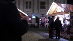 Sheepskin products stall and a sweets stall at the Christmas market, Graz Stock Footage