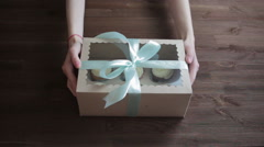 Woman hands giving gifts. Present made of recycled carton and  ribbon - stock footage