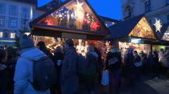 Street stalls with clothes and souvenirs at the Christmas market in Graz Stock Footage