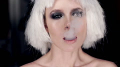 Professional fashion model exhaling smoke from a vaporizer shot in slow motion - stock footage