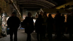 Tourists and locals walking at the Christmas market on Schlossberg hill in Graz Stock Footage