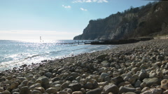 Pebble beach in strong sunlight - stock footage