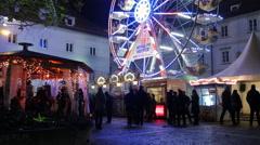 Walking by a ferris wheel at the Wonderlend at Mariahilferplatz in Graz Stock Footage