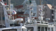 South Korean national flags on the masts of fishing vessels in Busan Stock Footage