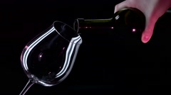 Bottle, glass with red wine, black, closeup, slowmotion Stock Footage