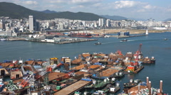 Barges and other vessels under construction in Busan port, South Korea Stock Footage