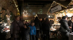 """Adults and children walking at the """"Aufsteirern"""" Christmas Market in Graz Stock Footage"""