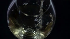 White wine being poured into a wineglass, bubble, view from above, black Stock Footage