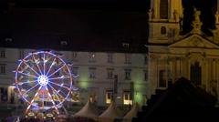 Ferris wheel near the Mariahilferkirche at Mariahilferplatz in Graz Stock Footage