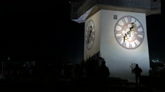 The Clock Tower seen at night on Christmas in Graz Stock Footage