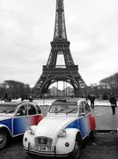 Citroen 2CV under the Eiffel Tower in Paris, France - stock photo