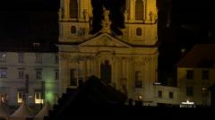 Pan view of the Mariahilferkirche and a ferris wheel at Mariahilferplatz in Graz Stock Footage