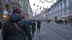 Walking by New Yorker and other stores on Herrengasse on Christmas in Graz Stock Footage
