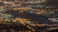 Night Airport Cityscape Time Lapse with Zoom out Burbank and Los Angeles Stock Footage