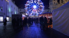 Walking by the stalls and the ferris wheel at Mariahilferplatz in Graz Stock Footage
