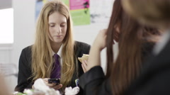 4K Happy teen girls talking during lunch break in school cafeteria - stock footage