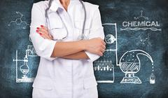 doctor with stethoscope and scheme chemical reaction - stock photo