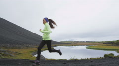 Person running - runner on jogging on cross country trail run in nature Stock Footage