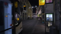 Tram number 5 moving on Sackstraße on Christmas in Graz Stock Footage