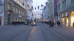 Tram moving on Herrengasse street on Christmas in Graz Stock Footage