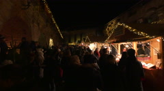 """Many people walking at the """"Aufsteirern"""" Christmas Market in Graz Stock Footage"""