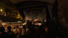"""The crowded """"Aufsteirern"""" Christmas Market on the Castle hill in Graz Stock Footage"""