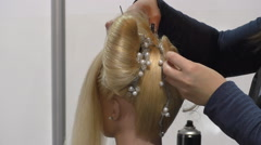 Hairstylist working Stock Footage