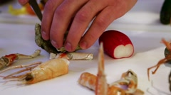 Person shucking fresh oysters with a knife,  cam moves to the left, closeup Stock Footage