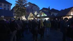 People walking at the Christmas market in Hauptplatz in Graz Stock Footage