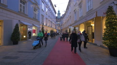 People walking by Oui store on Stempfergasse on Christmas in Graz Stock Footage