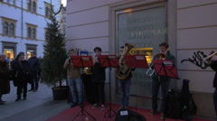 Musicians performing on Stempfergasse on Christmas in Graz Stock Footage