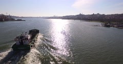 Aerial Footage Following an Anti Pollution Vessel Passing by the Golden Horn - stock footage