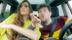 Funny couple dancing crazy in car having lot of fun slow motion Stock Footage